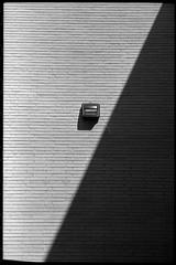 angles and shadows (FreezerOfPhotons) Tags: leicam5 leica leitz cosinavoigtlandernokton40mmf14sc singlecoatedlens fujineopan400 legacypro xtol shadow angle wall