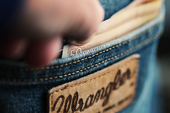 pickpocketing (Sabinche) Tags: macromondays crime money thief trouser pocket note macromonday jeans explored