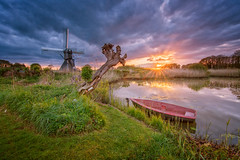 Between clouds (Diaan78) Tags: sunset water mill boat clouds grass light sun colors colorful holland netherlands 845 nikon