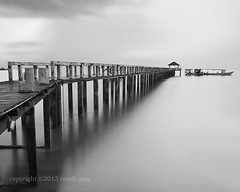 Jetty (Randi Ang) Tags: bw white seascape black monochrome canon indonesia landscape eos big long exposure jetty bajo north filter lee 5d ang sulawesi randi stopper utara wori kima minahasa
