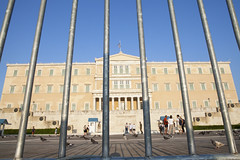 The Parliament in Athens, Greece. (Nasos Zovoilis) Tags: city travel blue white money macro building broken monument grave rock closeup architecture square soldier greek town ancient europe european state market crash euro background empty flag political country union capital tomb nation culture honor bank parliament landmark pride palace athens structure crack cash business greece zeus government worry economic metaphor acropolis tomp fragile financial problems economy currency crisis banking athina finance attica inflation bankrupt debt akropolis syntagma gfc bankruptcy hellenic bailout evzone vouli