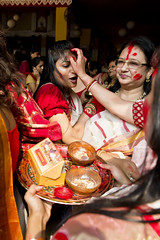 Sindur Khela - The Tools and the Action. (Anoop Negi) Tags: park ladies india religious photography photo women married delhi custom fertility rite anoop function puja cr durga vermillion negi bengali mithai chittaranjan sindhur ezee123 sindur khela vision:food=0514 baudhis