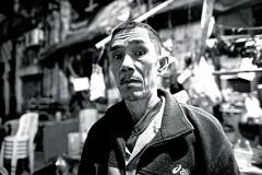 undecided (reinetor) Tags: street light shadow portrait people bw monochrome bar eos asia yangon burma picture 5d myanmar 24mm undecided 19th strolling mark3  primelens 5dmk3 ef24f14l ef24l