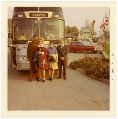 Departing by Bus from the Flying Dutchman Motel, 1971 (Alan Mays) Tags: ephemera photographs photos foundphotos colorphotos snapshots buses vehicles transportation bustours charters autos automobiles cars flyingdutchman flyingdutchmanmotel motels anchorroom anchorroomlounge tourists men women clothes clothing canadianflag flags mapleleaf mapleleafflags canada 1971 1970s antique old vintage vptp
