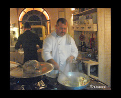 Chef-Tuscan Feast (The Bop) Tags: kitchen pots pans steam utensils concentration stiring bottles wine food assistant towels