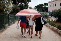 Ombrellone (polline) Tags: street whathappensinthestreets palermo sicily sicilia sud meridione italia streetphotography fujifilm x100t ombrellone mondello