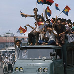 30 Apr 1975, Saigon, Vietnam --- Vietnamese celebrate after the fall of  Saigon. thumbnail