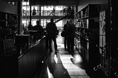 Book Lovers (Anne Worner) Tags: anneworner copenhagen denmark interior kastrup ricohgr airport architecture bw backlight bar candid counter lampsceiling rimlight street streetphotography blackandwhite silverefex