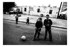 Children play outside in Aqaba, Jordan (Roman Lunin) Tags: jordan aqaba children kids street streetphotography outside blackwhite blackwhitephoto blackwhitephotography monochrome bw black reportage documentary