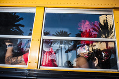NOLA BUS (Ben Helton) Tags: reflection bus window palmtrees mardigras nola red mask 28mm flash street photography candid streetphotography benhelton benheltonphotography blueskies yellowbus schoolbus fullfrontalflash fullfrontal