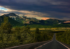 Sundown in the Mountains (Ruth Voorhis) Tags: sky sunset clouds mountains slopes hills trees grasses field outdoors road
