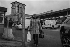 DR151210_0910D (dmitry_ryzhkov) Tags: market gate gates fence pretty prettywoman woman women lady sony alpha black blackandwhite bw monochrome white bnw blacknwhite bnwstreet day daylight one motion movement walk walker walkers pedestrian pedestrians sidewalk art city europe russia moscow documentary journalism street streets urban candid life streetlife citylife outdoor outdoors streetscene close scene streetshot image streetphotography candidphotography streetphoto candidphotos streetphotos moment light shadow people citizen resident inhabitant person portrait streetportrait candidportrait unposed public face faces eyes look looks