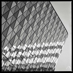 Reflective architecture (ShimmeringGrains) Tags: square kiaula planar8028 scannad mediumformat 6x6 bw kodakhc110b film zeissplanar8028 blackandwhite analogue ilford 120film mellanformat svartvitt hasselblad500cm hasselblad kvadrat kodakhc110 scanned analog ilfordhp5 architecture monochrome ©marieahlén geometric karolinskainstitutet stockholm sweden pattern reflections innovativearchitecture