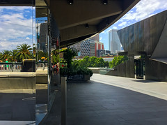 Angles and reflections (Marian Pollock (Weiler)) Tags: australia melbourne victoria southbank reflections theatre clouds angles architecture people walking distorted mirror signs swanstonstreetbridge palms sunny outdoors bushes hamerhall concerthall contrast