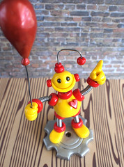 Commission: 1st Birthday Cake Topper: yellow and red with a balloon (HerArtSheLoves) Tags: birthday red yellow cake silver one robot mixed wire media shiny child heart ooak small balloon gear clay tiny custom commission base topper geeky polymer