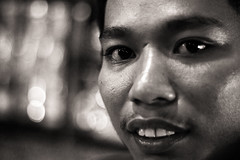 Live from planet Pluto (Triple_B_Photography) Tags: travel portrait blackandwhite bali holiday blur male men smile bar canon indonesia 50mm prime eyes bokeh candid venue sanur 500d