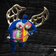 the nana that watches over travellers at Zurich trainstation (lunaryuna) Tags: sculpture art beauty switzerland colours zurich nana lunaryuna nikidesaintphalle artinpublicspace femaleform zurichhauptbahnhof angelicnana