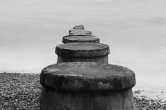 Disappear into the Ocean (SMugridge) Tags: wood old white mist black canon vintage 350d blackwhite exposure pebble nd eastbourne groyne 70200mm neutral