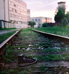 Lost sneaker on tracks (Specialissima) Tags: sunset magichour abandonedbuildings portra400 tallinnestonia kalamaja oldtallinn converseshoe rundownfactories abadonedshoe olympusrd35 tallinnsummer grittypartoftown