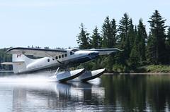 BTU touching down (T.Cochrane) Tags: blue lake water plane canon aviation canadian manitoba landing otter float turbine dehavilland bissett 550d t2i dhc3t cgbtu