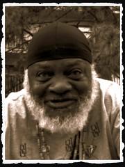 WHISKERS! (marsha*morningstar) Tags: man black male smile hat beard whiskers africanamerican