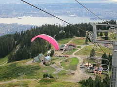 Two ways of sitting in mid-air (Ruth and Dave) Tags: city mountain vancouver flying wire sitting lift view cable tourists resort northshore burrardinlet northvancouver paragliding grousemountain paragliders chairlift
