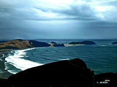 Cape Reinga, New Zealand. (Ahsan. (off until mid Sept)) Tags: ocean blue light sea newzealand cloud white mountain seascape blur green tourism beach nature water beauty clouds contrast canon landscape photography interesting focus colours afternoon dof pacific infinity wave cape northisland effect  canon7d 1755usm