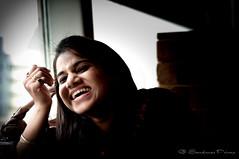 Hilarious Laughter (SandmaxPrime) Tags: pink girls portrait woman sunlight india window girl smile face laughing dark nose photography prime nikon women candid lips spotlight portraiture laugh laughter mumbai candidshots nikkor50mm nikon50mm d5000
