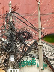 The Usual Asian Electrical Nightmare (mikecogh) Tags: wires electricity phnompenh nightmare poles spaghetti incredible tangle coils