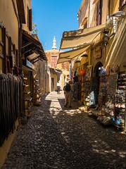 Old Town Street (Rhodes Town) (Fuji XM-1 & 16 -50mm Zoom) (markdbaynham) Tags: old island greek town fuji hellas x greece grecia trans rodos rhodes fujinon csc dodecanese hellenic xm1 mirrorless 1650mm digitaldepotcouk