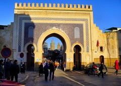 Lady in red (halifaxlight) Tags: blue red people gold gate afternoon shadows entrance sunny morocco medina crowds minarets fes feselbali theperfectphotographer ilovemypics