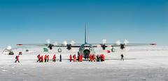 Summer people leaving South Pole (redfurwolf) Tags: southpole southpolestation lc130 airplane airguard antarctica people ice snow out sky redfurwolf sonyalpha sony sal70200g2
