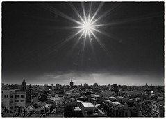 CityscapeBW (Мaistora) Tags: cityscape scape landscape skyscape sun sunrise sunshine flare star rays beams starburst houses buildings architecture churches towers belltowers spires steeples rockets missiles skyward sunny warm hot clear blue wide wideangle ultrawide lens sony sel1018oss alpha ilce a6000 lightroom bw blackandwhite mono monochrome print paper silver film analog analogue nik silverfx