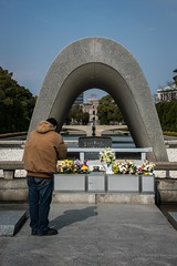 A man prays at the cenotaph memorial for the victims of the Atomic bomb that exploded over Hiroshima. (tommcshanephotography) Tags: abomb asia atomicbomb cenotaph hiroshima japan memorial travel ww2 war bomb