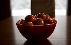 The orange bowl (savard.photo) Tags: alone snow orangecolour calmness stilllife woodentable bowl clementines