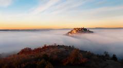Cordes-Sur-Ciel (Laurent BASTIDE Photographies) Tags: cordes france europe village français nuages mer brume automne sunrise matin froid jaune bleu arbres collines sud ouest pose longue