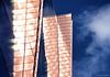 Sunlit Exterior (manxmaid2000) Tags: birmingham nia nationalindoorarena reflection blue gold copper facade city architecture england reflect bright glass window exterior shiny