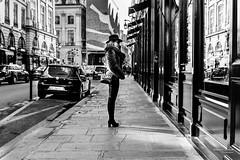 Street - Lonely shopping (François Escriva) Tags: street streetphotography photo rue noir balnc candid olympus omd nb black white bw hat fashion woman buildings sky sun light shops shopping cars saint honoré