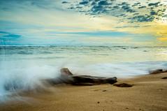 Ocean Splash (guppii) Tags: beach ocean water sand wave splash sky sunset wood sony nex kitlens 1855mm haida nd64x longexpo longexposure holiday malang indonesia landscape nature