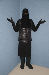Slave Waitress (Buses,Trains and Fetish) Tags: waitress maid slave girl warm hot winter sweat torture coat anorak niqab hijab burka chador boots fur