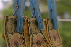 Money Laundering Is A Crime (Caroline.32) Tags: crime macromondays macro money laundering clothesline clothespins pegs nikond3200 extensiontube12mm niftyfifty 50mm18