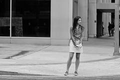 Eeuw! (burnt dirt) Tags: houston texas downtown city town mainstreet street sidewalk corner crosswalk streetphotography fujifilm xt1 bw blackandwhite girl woman people person phone cellphone purse bag standing walking disgusted repulsive facial expression shocked longhair