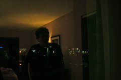 (oceanos_) Tags: lighting city light boy reflection night digital canon hotel empty nighttime citylights stare dim gaze hotelroom dimlit canonrebelxti