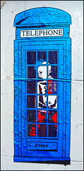 Punk in a blue telephone box (tim constable) Tags: street city uk blue windows urban london art church sign skyline buildings private poster graffiti tv stencil bars mural punk closed comic quiet view surveillance noparking watch property cage cctv security scene backstreet attitude brickwall cameras alleyway observe shoreditch spraypaint aerosol scape bricklane effect circuit protection juxtapose telephonebox grilles cityoflondon clamping closeto nextto cagedanimal