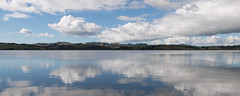 Still (Mike Brebner) Tags: winter sea newzealand cloud seascape reflection water clouds reflections landscape coast seaside view cloudy harbour scenic july scene reflected coastal nz northisland northland mangonui doubtlessbay 2013 cmikebrebner