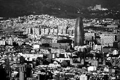 IMG_6295Axx (kanizfotolio) Tags: barcelona city black canon lens landscape eos spain europe torre signature crowd bcn spanish kits population agbar 400d