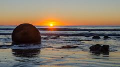 Moeraki Boulders Sunrise (Kathrin & Stefan) Tags: ocean morning sky sun beach nature rock sunrise sand outdoor wave boulder pacificocean moerakiboulders kaihinaki