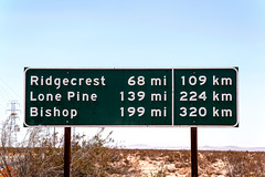 Ridgecrest/Lone Pine/Bishop (Curtis Gregory Perry) Tags: california green sign pine mi nikon button lone miles mileage copy bishop km reflector 109 139 320 ridgecrest 68 224 adelanto kilometers