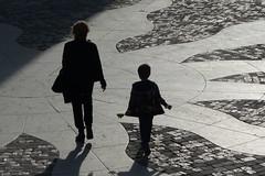 Walking (evisdotter) Tags: street light italy woman shadows child patterns silhouettes sunny rimini streetshot platinumheartawards platinumpeaceaward mygearandme mygearandmepremium