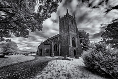 Birth place of a hero (David Feuerhelm) Tags: nikkor bw monochrome blackandwhite outdoors outside contrast wideangle norfolk church building tower sky clouds trees foliage nikon infrared silverefex d90